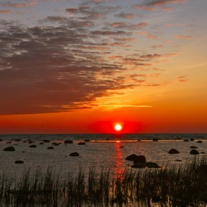 Sunrise at stony shore in Mersrags, Latvia