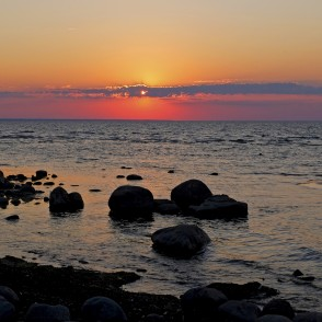 Sunset at stony shore in Mersrags, Latvia