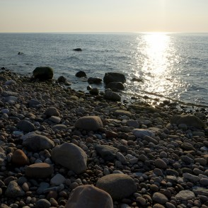 Stones at Coastline of Baltic Sea at Sunset