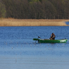 An Angler in a Boat in a Lake